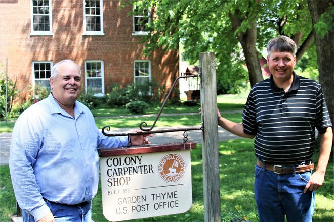 Rep. Dan Swanson, R-Alpha, left poses with Todd DeDecker at Colony Carpenter Shop in Bishop Hill. The Bishop Hill Heritage Association will receive a $100,000 state grant from the state for a variety of construction projects on historic buildings in the village.