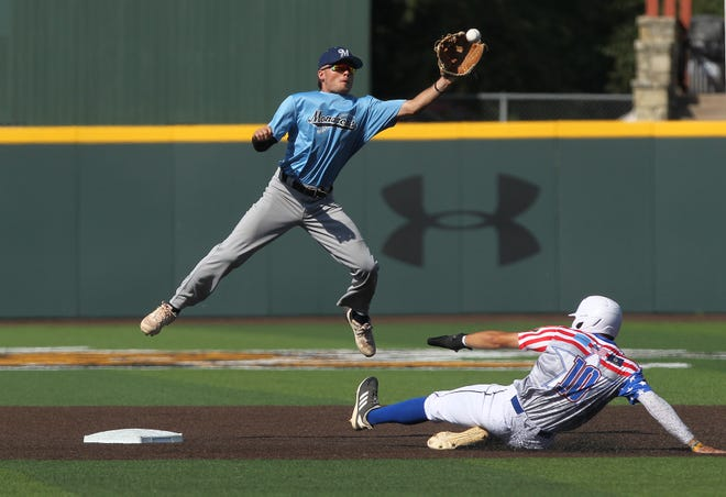 Hutchinson Monarch's second baseman Easton Loyd left, stops the ball and attempts to tag Great Bend Bat Cat's Noah Best (10) out Monday evening at Eck Stadium in Wichita. The Monarchs defeated the Bat Cats 5-1.