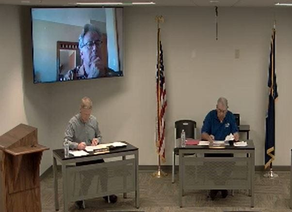 The Reno County Commission on Tuesday continued discussions on the expansion of the commission board from three to five members. Commissioner Ron Sellers, on the screen, attended remotely.