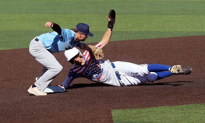 Hutchinson Monarch's Easton Loyd (10) misses the tag against Great Bend Bat Cat's Noah Best (10) at second base Monday evening at Eck Stadium in Wichita. The Monarchs defeated the Bat Cats 5-1.