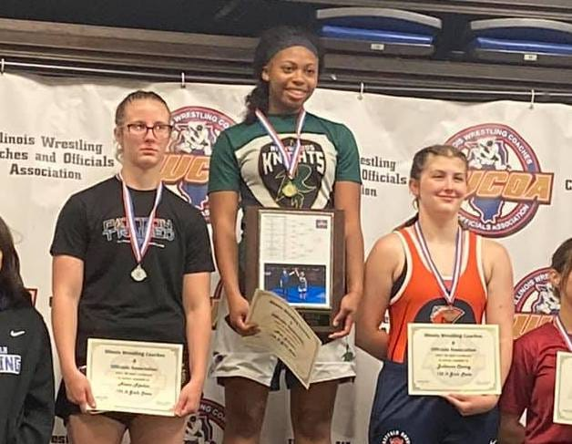 Richwoods wrestler Arie Johnson, center, won the 152-pound girls state championship at the Illinois Wrestling Coaches and Officials Association state championships on Monday.