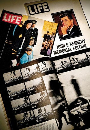 The assassination of President John F. Kennedy was depicted in the pages of the Nov. 29, 1963, edition of Life magazine with the frame-by-frame sequence of the Zapruder film. Also in the photo is the Dec. 6, 1963 edition featuring First Lady Jacqueline Kennedy and her daughter Caroline and son John Jr. at the funeral procession in Washington D.C., and the special JFK Memorial Edition. The Zapruder film was obtained for Life by Pekin native Dick Stolley, who died last week at age 92.