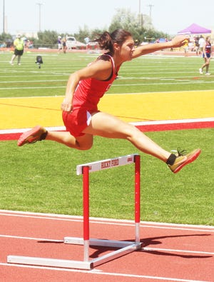 Crowley County High School's Lani Brown clears a hurdle in the Rocky Ford Invitational on June 11. Brown has qualified for state in three events. The state meet begins Friday and ends Saturday at Jefferson County Stadium in Lakewood.