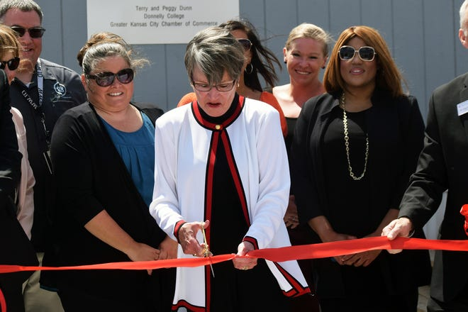 Gov. Laura Kelly cuts a ribbon Tuesday to dedicate the new Lansing Career Campus, which is located on the grounds of the Lansing Correctional Facility.