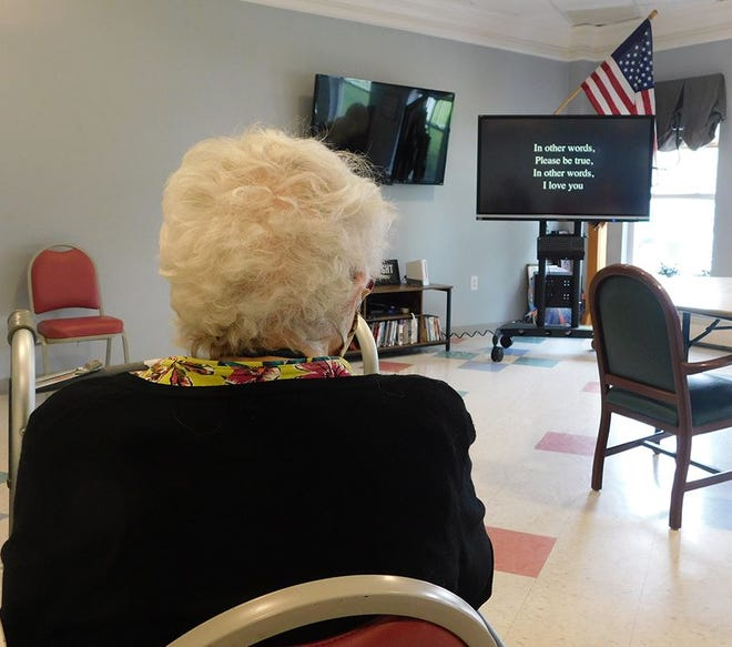 Marilyn Fegyo participates in a sing-along using iN2L, a technology that offers content-driven engagement, cognitive and physical exercise and therapy, education and memory support to residents of Westwood Commons in North Chili.