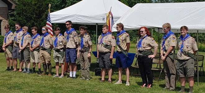 Members of Troop 208 in Fairport earn their Eagle Scout ranks during a Court of Honor ceremony. Pictured, from left, are RJ Jacobson, Quinn Mooney, Tyler Brown, Ben Jacobson, Cadin Hickey, Collin Granville, Trevor Kaiser, Cameron Cannioto, Reed Mooney, Douglas Webb, Jack Bailey, Bryan Webb and Alex Pelletier.