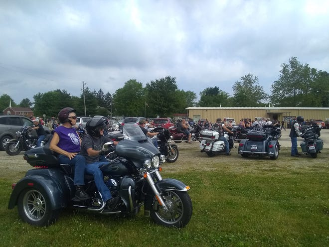 Motorcycles lined up on the grass in preparation for the start of Silvie's Ride Saturday morning.