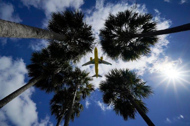 An airliner lands at Tampa International Airport in Tampa, Florida, on March 19. [AP File Photo/Gene J. Puskar]