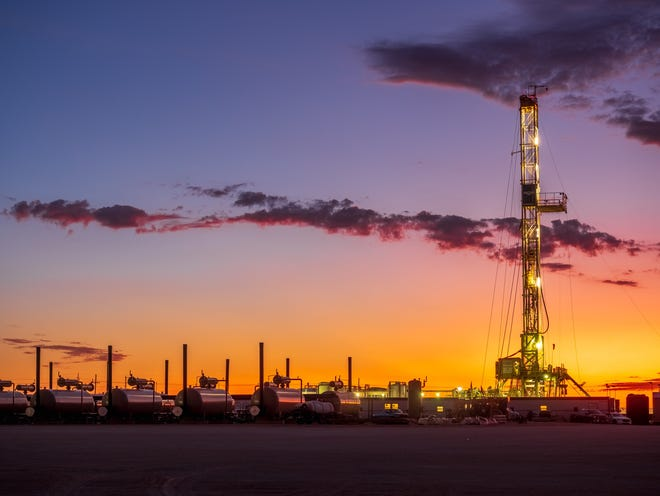A rig drills a well at a Delaware Basin location. New laws and regulations aimed at addressing climate change will require the nation's energy industry to innovate, Devon Energy's top executive says.