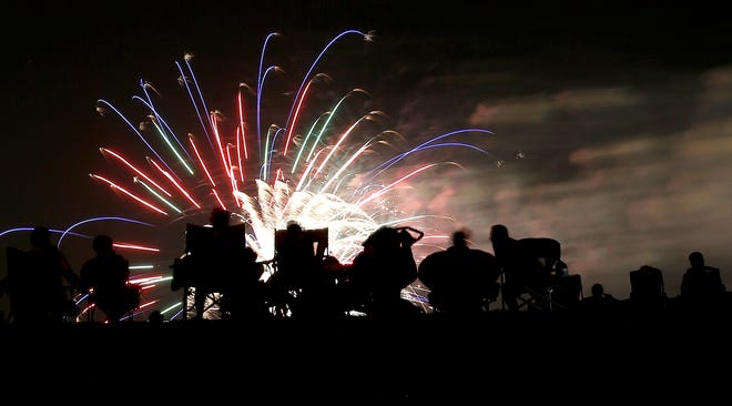 People watch fireworks July 3, 2016, at Yukon's Freedom Fest Tribute to Veterans in Chisholm Trial Park in Yukon.