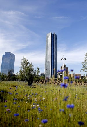 Well into its second summer, Scissortail Park's maturing foliage frames new views of the downtown Oklahoma City skyline. The city of Oklahoma City will pay $3.6 million this year to the Scissortail Park Foundation to manage the MAPS 3 downtown park.