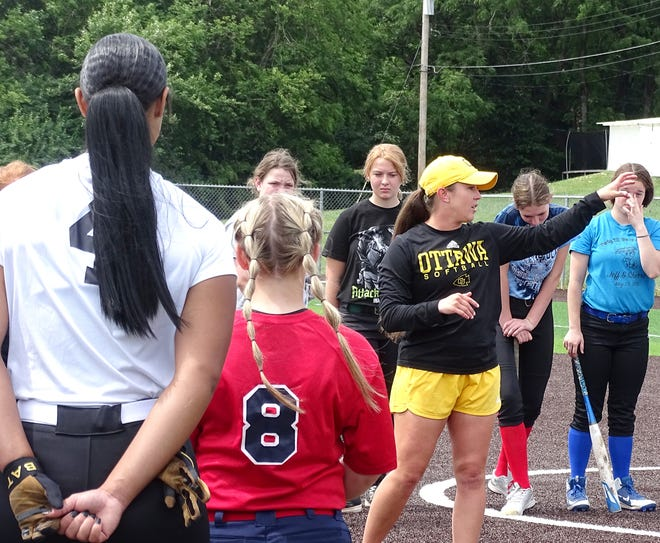 Ottawa University assistant softball coach Sam Mendez points out tips on hitting before the hitting drill during the softball camp for high school players this week.