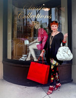 Sally Kimball, owner of the Classic Collections of Palm Beach consignment store, stands in front of her curved display window on Monday. The store is closing Saturday after fourteen years.