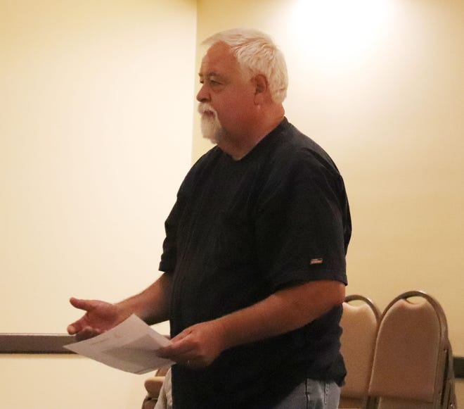 Pontiac resident Bruce Baker addresses the city council at its meeting Monday evening at the Eagle Theater. Baker's request was for the city to remove a tree that he said poses a danger to his house and power lines. The tree lies in the city right-of-way. The city denied his request.