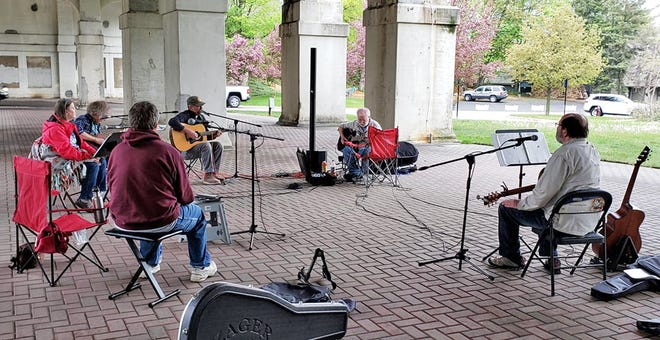 People gather under the bridge on the Bear River every other week on Wednesdays for an open jam and to share stories and songs.
