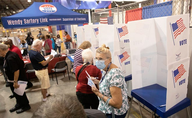 Voters fill out sample ballots at a demonstration polling station during a tour of the elections process at the Voting Equipment Service Center in Riviera Beach Tuesday, June 22, 2021.
