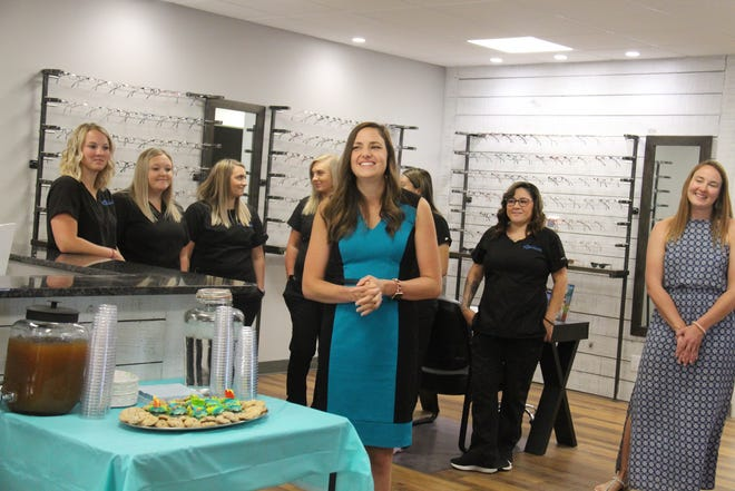 Cassie Martinson welcomes guests to Eye Care Associates during a ribbon cutting ceremony on Tuesday, June 22.