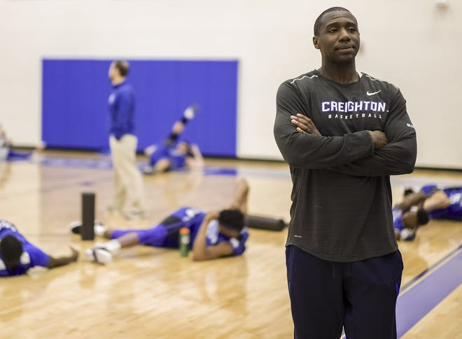 Creighton assistant coach Preston Murphy, who played at URI and was an assistant in Kingston, watches as players warm up before practice in March 2017. On Tuesday, Murphy was found guilty of accepting $6,000 to steer student-athletes to a certain management company while at Creighton.