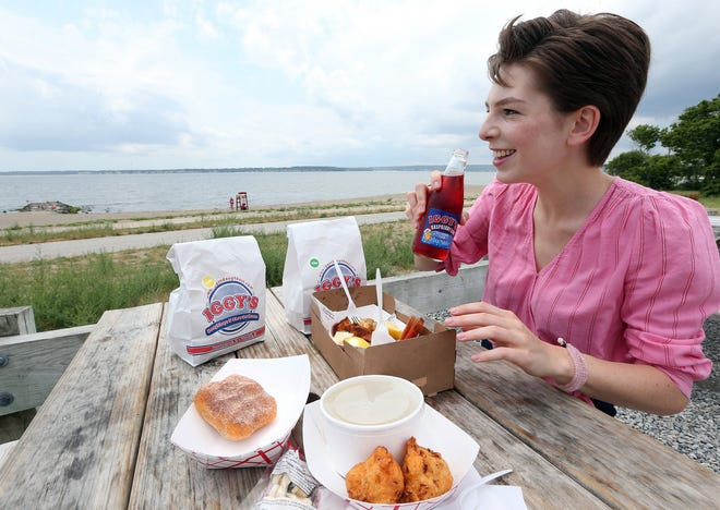 Providence Journal writer Amy Russo takes in the scenery at Warwick's Oakland Beach while eating some local fare from Iggy's Doughboys & Chowder House.