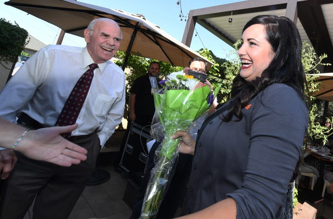 Frances Richardson is congratulated by Doug Wilhoit, left, after being surprised by Tim Quinn of the Greater Stockton Chamber of Commerce with the announcement that she is the 2019 Athena Young Professional Leadership Award recipient on Sept. 12, 2019.