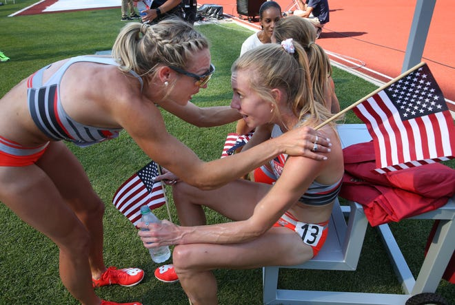 Elle Purrier St. Pierre, left, the women's 1,500-meter winner, congratulates third-place finisher Heather MacLean after both made their first Olympic team Monday at the U.S. Olympic Track & Field Trails at Hayward Field.