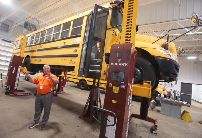Dan McGrath, Massillon City Schools transportation director, talks about the new computerized bus lifts. The district renovated the former Washington High School building into the operations facility. For the first time in 30 years, the district's mechanic and the buses will be housed at the same location.
