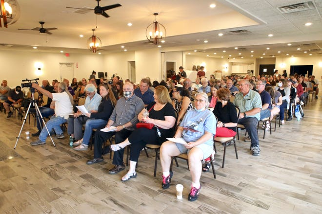 A community meeting for discussions about environmental impact and concerns with the Chemtool fire, is held Monday, June 21, 2021, in a banquet room at Mary's Market in Roscoe.