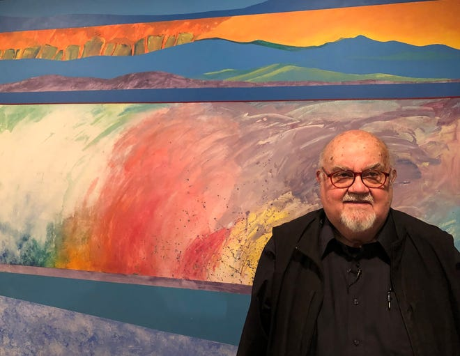 """Goshen artist Abner Hershberger stands in front of his 1977 painting, """"Monte Acuto Region,"""" now on display at the Midwestern Museum of American Art in Elkhart."""