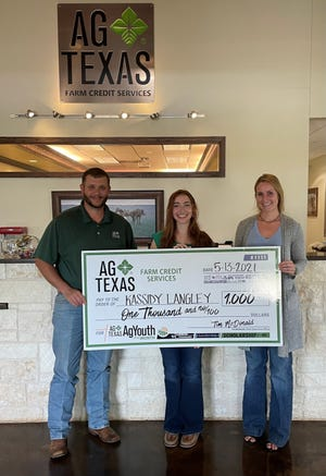 Kassidy Langley with Hico FFA was awarded a $1,000 scholarship. Here she is pictured with Keith Davis and Summer Stevens.