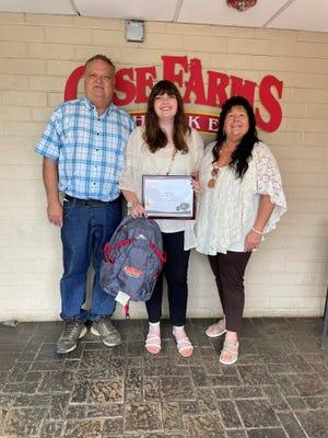 Ashley Luckadoo, center, won a scholarship from Case Farms.