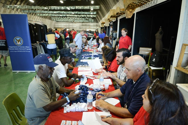 Hundreds of homeless veterans receive assistance during a Stand Down event in 2015. The initiative returns on June 26 from 8 a.m. to noon at the Sarasota County Fairgrounds.