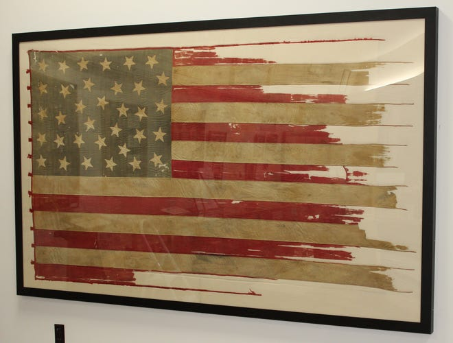 """This 34-star flag carried by the Indiana Volunteer Infantry will be on display when Springfield's Grand Army of the Republic Memorial Museum opens again July 1. The flag was presented to Company G of the Indiana infantry in July 1861 by the """"ladies of Lima, Indiana."""""""