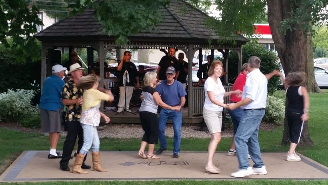 """Dancers cut a rug on the dance floor, which was added to the concert park series about five years ago. The """"2021 Concert in the Park"""" Series is in its 25th year and will kick off on Thursday, June 24 with the Jim Markum Swing Band at Veterans Park."""