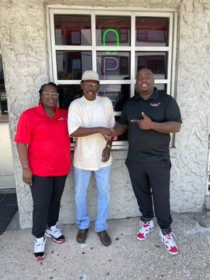 "Phallin Scott (left), Lynwood ""Booty"" Davis (center) and Corey Scott on Castle Street in downtown Wilmington."