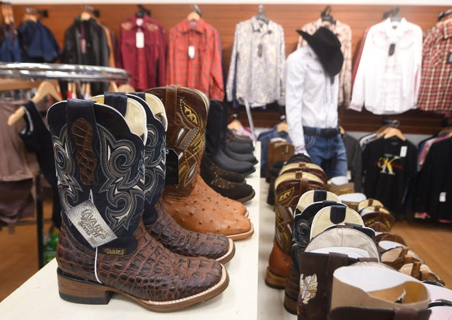 Recently opened Gema's Boutique displays cowboy boots at Independence Mall in Wilmington, N.C., Tuesday, June 22, 2021. The mall has added several new stores and restaurants within the past year.     [MATT BORN/STARNEWS]
