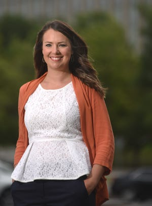Sarah Arthur, Manager of Community Engagement at Novant Health - New Hanover Regional Medical Center, stands in front of the hospital in Wilmington, N.C., Tuesday, June 22, 2021. Arthur is one of the StarNews 40 Under 40 honorees for 2021.