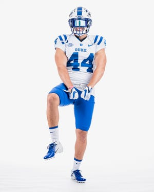 West Brunswick's Carter Wyatt poses in a Duke uniform while on an official visit with the Blue Devils earlier this summer.
