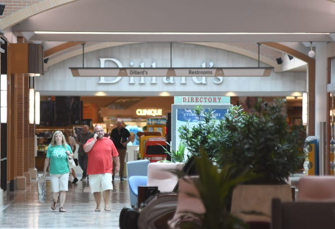 People walk past stores at Independence Mall in Wilmington, N.C., Tuesday, June 22, 2021. The mall has added several new stores and restaurants within the past year.     [MATT BORN/STARNEWS]