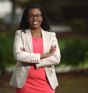 Marissa Bryant Franks, Health Equity Outreach Coordinator at Novant Health - New Hanover Regional Medical Center stands in front of the hospital in Wilmington, N.C., Tuesday, June 22, 2021. Bryant Franks is one of the StarNews 40 Under 40 honorees for 2021.