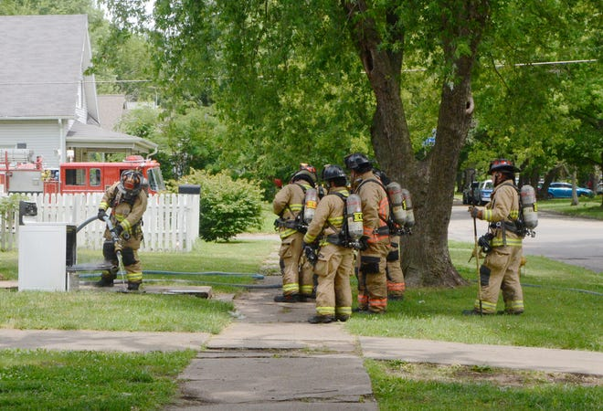 Three fire trucks, two command vehicles and ten Pittsburg Fire Department personnel responded to a cooking fire Monday that luckily did not spread beyond the oven, which firefighters removed from the house.