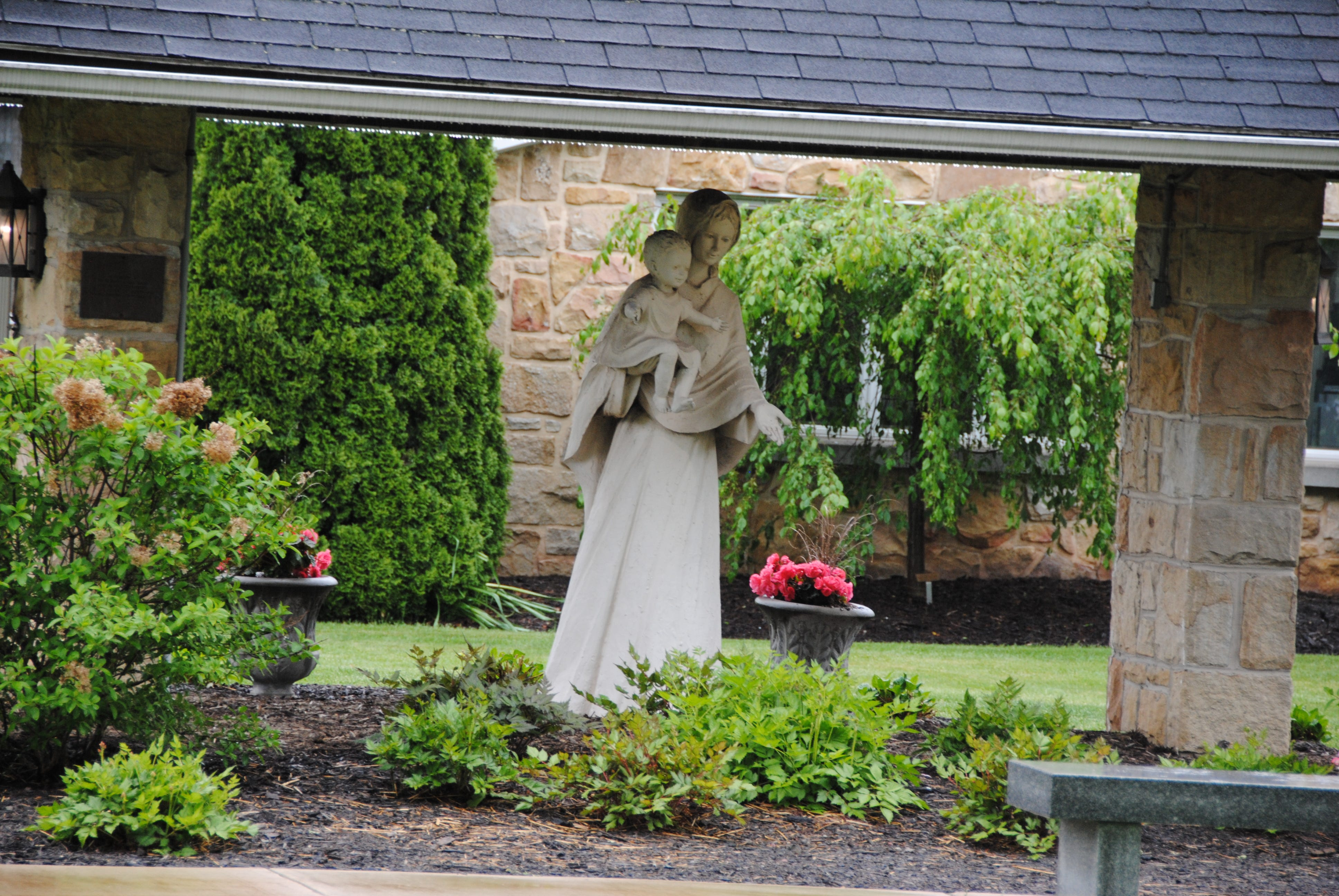 A statue of a woman and child is positioned outside of St. Peter's Catholic Church in Somerset.