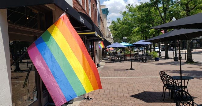 Businesses along Hay Street in downtown Fayetteville display Pride flags on Monday afternoon, June 21, 2021. June is Pride Month, which celebrates the LGBTQ community.