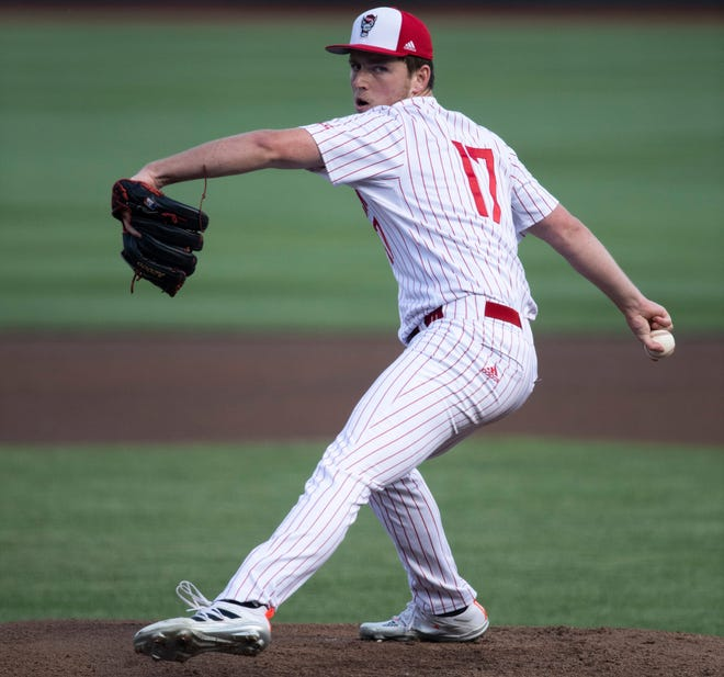 NC State pitcher Sam Highfill (17) throw a pitch in the first inning against Vanderbilt during game six in the College World Series on Monday night in Omaha, Neb.