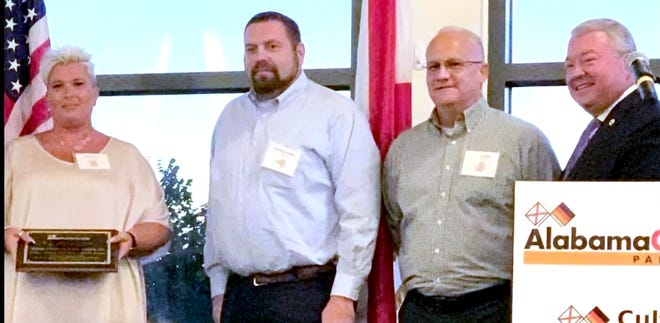From left, Tina Gibson, Matthias Goetz and Calvin Tyler of the Fehrer Automotive plant in Gadsden and Alabama Secretary of Commerce Greg Canfield are seen at a ceremony honoring Fehrer for its recent investments and expansion.