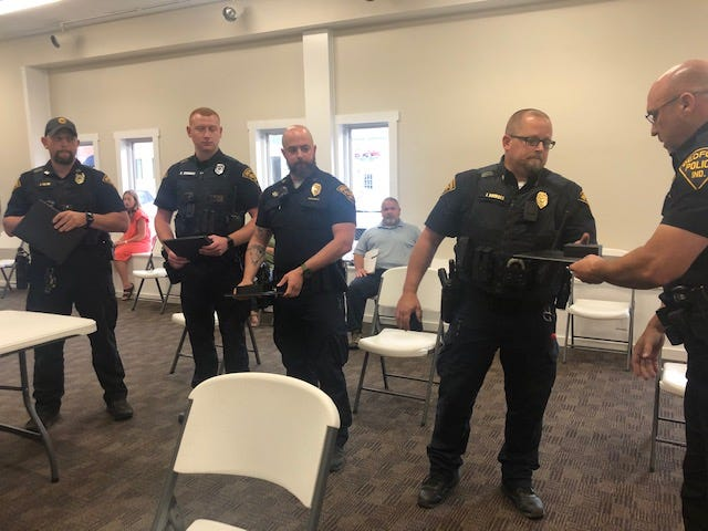 Capt. Jesse Crane, officer Kody Emmons, Sgt. Blake Wade and Maj. Jeremy Bridges receive commendations from BPD Chief Terry Moore, right, at Monday's Bedford Board of Works & Safety meeting. Officer Clint Swanson also received a commendation but was not able to attend.