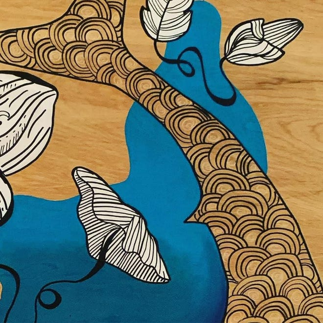 A detail shot of a Sara Sterling Griffith piece painted on wood.