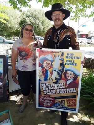 Kolton Miller shows off the poster for the First Annual Roy Rogers and Dale Evans Western Film Festival with his mother, Kristin Miller, in Barstow.