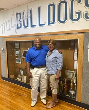 Newly-hired Milford head football coach and athletic director Isaac Wells and his wife, Coella Wells, pose for a photo at Milford High School. Wells was hired by the Milford ISD board of trustees in June.