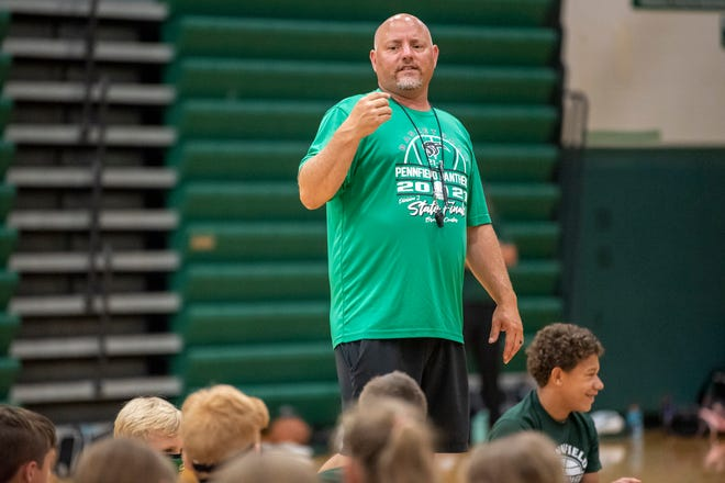 Head basketball coach Nate Burns welcomes students to basketball camp on Monday, June 21, 2021 at Pennfield High School.