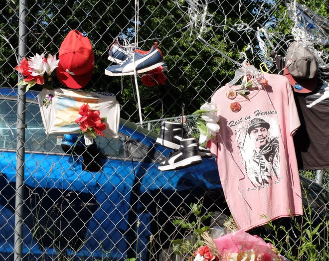 A memorial to a homicide victim outside the convenience store where two children were shot on June 12.